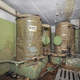 Large tanks with a supply of drinking water in the underground abandoned shelter - PhotoDune Item for Sale