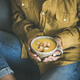 Woman sitting and holding warming pumpkin soup in mug - PhotoDune Item for Sale