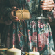 Woman holding glass of champaigne and gift box in hands - PhotoDune Item for Sale
