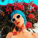 Lady in fashion beach accessories. Head scarf, sunglasses and ea - PhotoDune Item for Sale