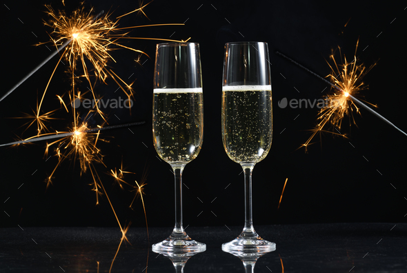 glasses with champagne and sparkles - Stock Photo - Images