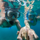 Underwater view of couple snorkeling - PhotoDune Item for Sale