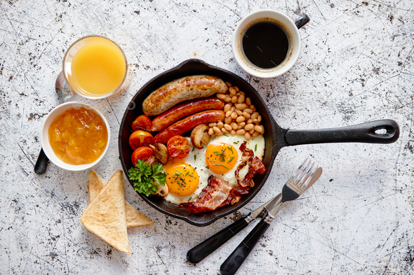 Delicious english breakfast in iron cooking pan - Stock Photo - Images