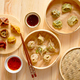 Traditional chinese dumplings served in the wooden bamboo steamer - PhotoDune Item for Sale