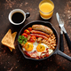 Delicious english breakfast in iron cooking pan - PhotoDune Item for Sale