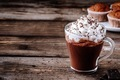 Hot chocolate drink with whipped cream in a glass on a wooden background - PhotoDune Item for Sale