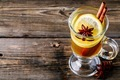 Hot spiced Apple cider Toddy with lemon, honey and cinnamon stick in glass on wooden background - PhotoDune Item for Sale