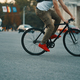 Closeup of casual man legs riding classic bike on city road - PhotoDune Item for Sale