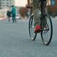 Closeup of casual man legs riding classic bike on city road - PhotoDune Item for Sale