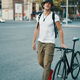 Portrait of young man walking with thoughtfully classic bicycle - PhotoDune Item for Sale