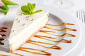 Classical New York Cheesecake with mint on white plate close up - PhotoDune Item for Sale