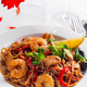 Rice noodles with shrimps in sauce on a white plate, close up - PhotoDune Item for Sale