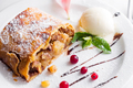 Apple strudel with vanilla ice cream and mint and berries on white plate, close up - PhotoDune Item for Sale