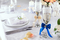 edding champagne glasses on white tablecloth with table setting on white, close up - PhotoDune Item for Sale