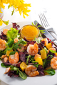 Healthy salad with prawns, lettuce, oranges and mango served on a plate with orange mustard sauce - PhotoDune Item for Sale