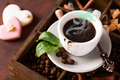 Close up cup of coffee on a wooden box with grains of coffee and mint - PhotoDune Item for Sale