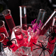 cocktail in glass tubes in an ice bucket with black spiders and a spider web in the background for - PhotoDune Item for Sale