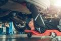 Car Mechanic Under the Car - PhotoDune Item for Sale