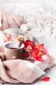 A cup of healthy tea in yellow red leaves with beige scarf on white wooden background, copy space - PhotoDune Item for Sale