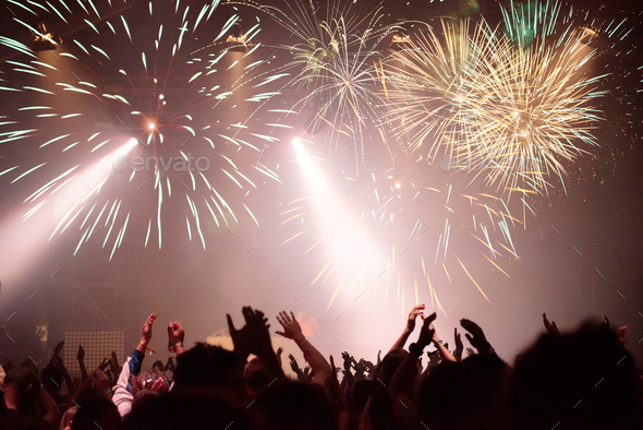 Fireworks and crowd celebrating the New Year. Space for text - Stock Photo - Images