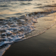 Waves approaching sandy beach during golden sunset - PhotoDune Item for Sale