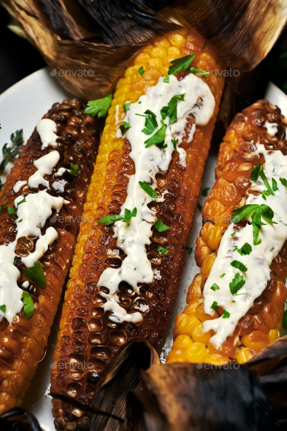Grilled corn cobs on plate, top view - Stock Photo - Images