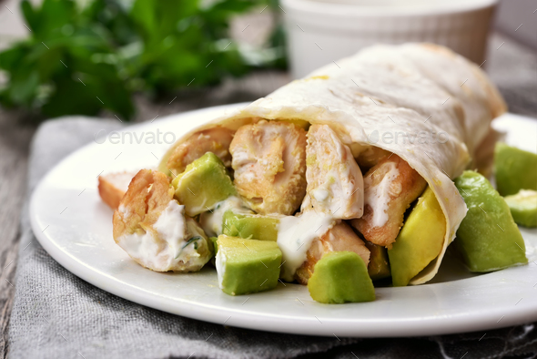 Wrap sandwich with chicken and avocado - Stock Photo - Images