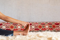 Woman doing physical exercise and stretching legs, feet close up - PhotoDune Item for Sale