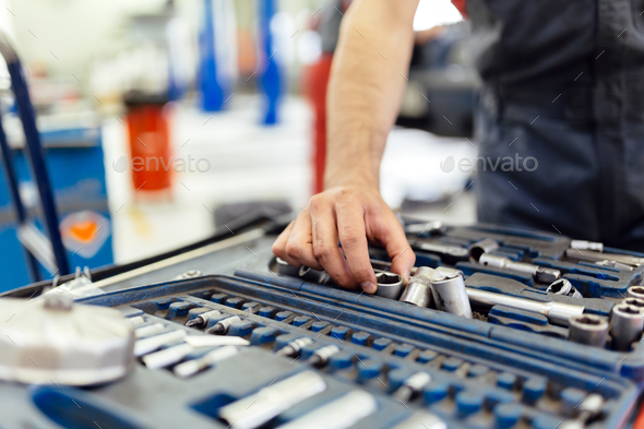 Car mechanic selecting the right tool - Stock Photo - Images