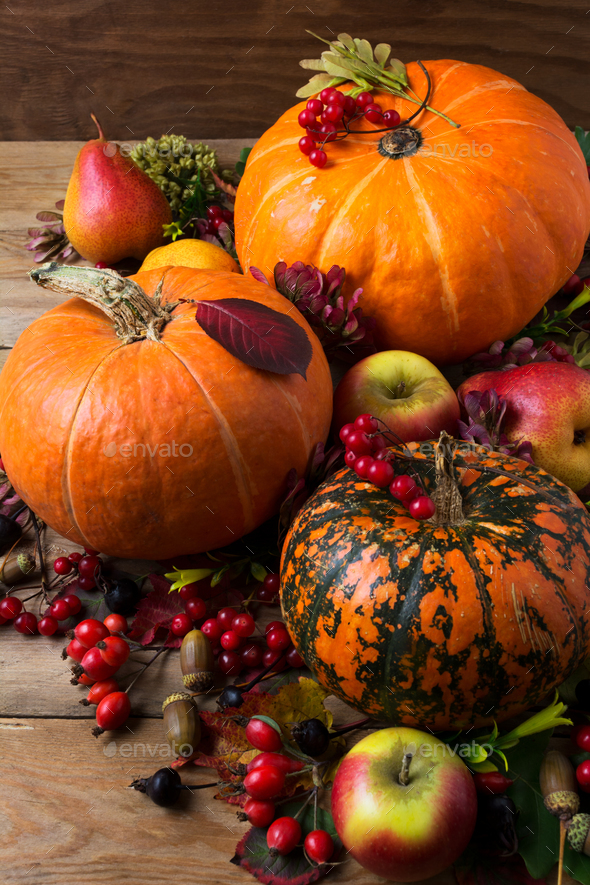 Fall rustic decor with three orange pumpkins - Stock Photo - Images