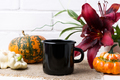 Black campfire enamel mug mockup with pumpkin and red lily - PhotoDune Item for Sale