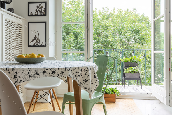 Real photo of a scandi dining room interior with a patterned clo - Stock Photo - Images