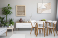 Real photo of bright dining room interior with wooden table and - PhotoDune Item for Sale