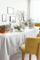 Yellow chair at table with tableware in bright dining room inter - PhotoDune Item for Sale