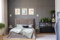Dark bedroom interior with a comfy double bed, posters, black sh - PhotoDune Item for Sale
