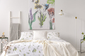 A pastel bedroom interior with a bed dressed in green plants pat - PhotoDune Item for Sale