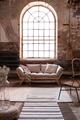 Window above grey wooden settee in spacious living room interior - PhotoDune Item for Sale
