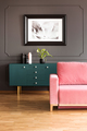 Poster above green cupboard in grey loft interior with pink couc - PhotoDune Item for Sale