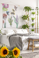 Urban jungle bedroom interior with sunflowers in the foreground - PhotoDune Item for Sale