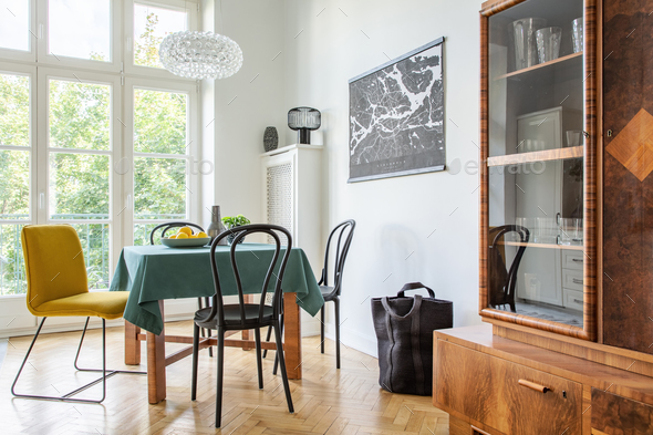 Retro dining room interior with a table, chairs and cupboard in - Stock Photo - Images