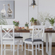 White chairs at wooden table in cottage dining room interior wit - PhotoDune Item for Sale