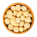 Roasted macadamia nuts in wooden bowl over white - PhotoDune Item for Sale