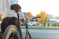 Businessman on a bike. Business man leaving his work. From back. - PhotoDune Item for Sale