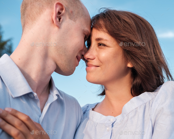 Young couple  looking on each other with love. - Stock Photo - Images