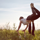 two woman on field doing fitness yoga - PhotoDune Item for Sale