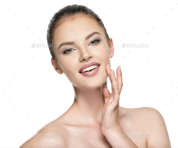 Beautiful woman cares for the skin face - isolated on white - Stock Photo - Images