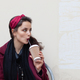 brunette female drinking coffee in plaid - PhotoDune Item for Sale