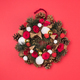Beautiful Christmas wreath decoration on red background - PhotoDune Item for Sale