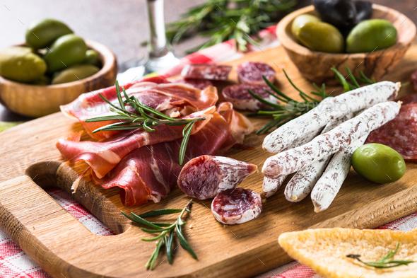 Antipasto delicatessen - sliced meat, ham, salami, olives on woo - Stock Photo - Images