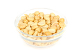 Roasted and salted peanuts in glass bowl over white - PhotoDune Item for Sale